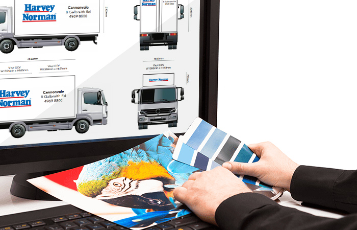 graphic designer matching colours for truckskinz print application
