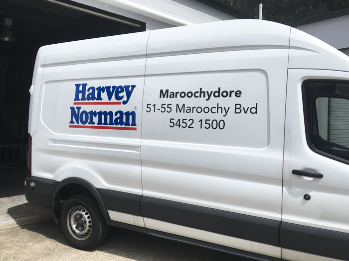 harvey norman van with vinyl advertising