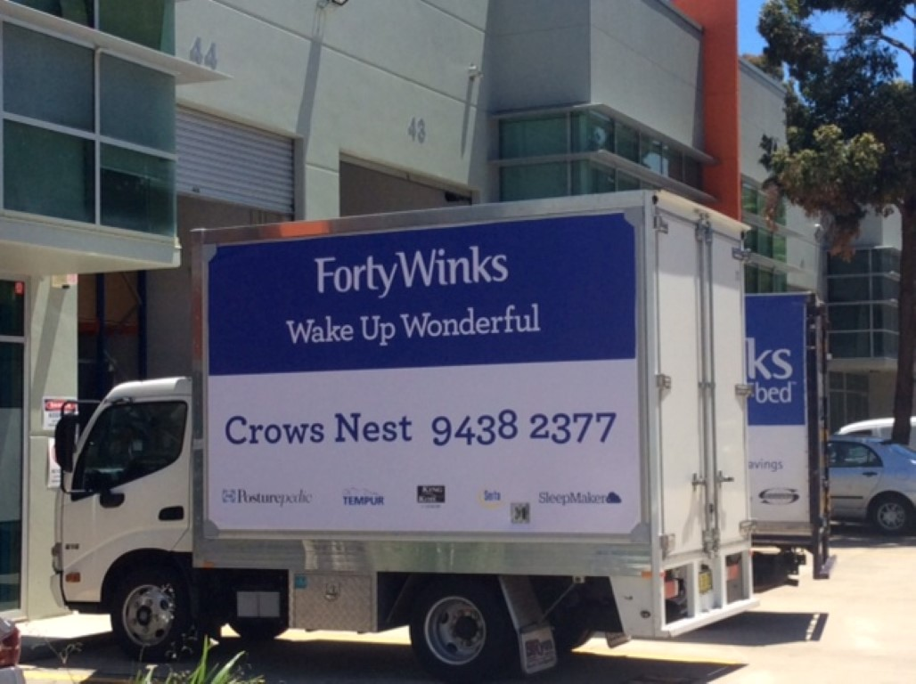 forty winks truck with truckskinz advertising wrap application